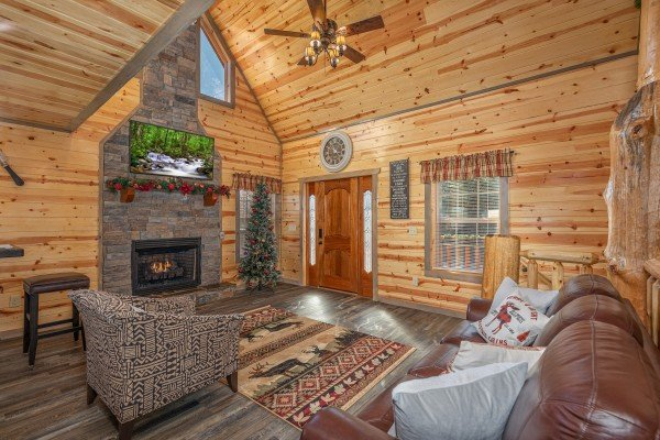 Fireplace, TV, and seating in a living room at Allstar Pool Lodge, a 4 bedroom cabin rental located in Pigeon Forge
