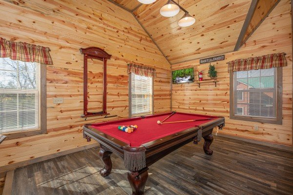 Pool table at Allstar Pool Lodge, a 4 bedroom cabin rental located in Pigeon Forge