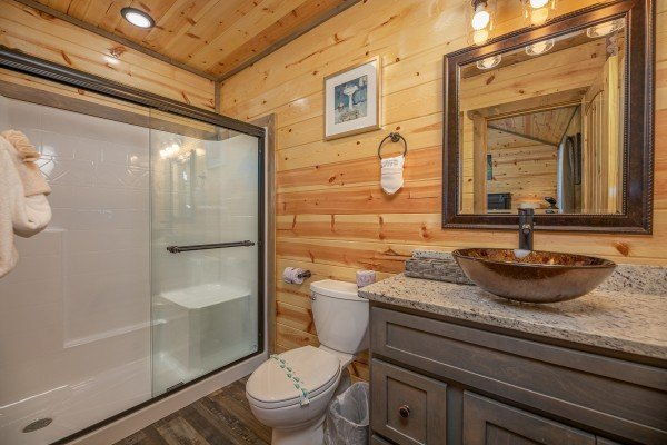 Bathroom with a walk in shower at Allstar Pool Lodge, a 4 bedroom cabin rental located in Pigeon Forge