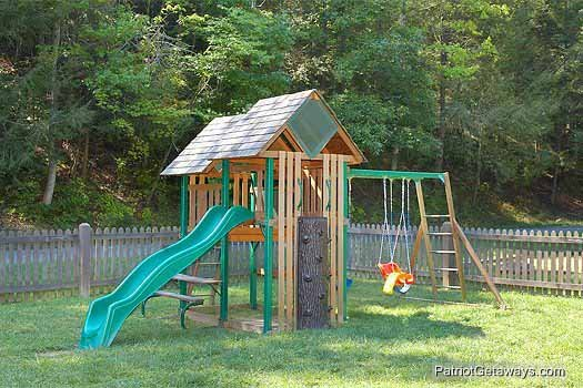 Playground access for guests at Allstar Pool Lodge, a 4 bedroom cabin rental located in Pigeon Forge