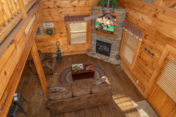 Looking down on the living room at Livin' Simple, a 2 bedroom cabin rental located in Pigeon Forge