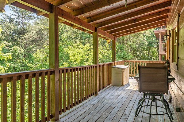 Covered deck at Livin' Simple, a 2 bedroom cabin rental located in Pigeon Forge