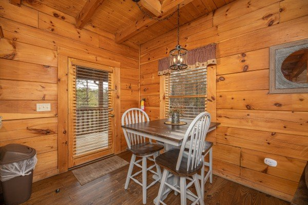 Dining table for two at Livin' Simple, a 2 bedroom cabin rental located in Pigeon Forge