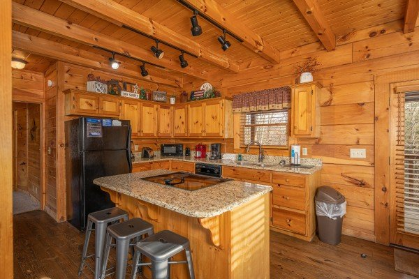 Kitchen with island and black appliances at Livin' Simple, a 2 bedroom cabin rental located in Pigeon Forge