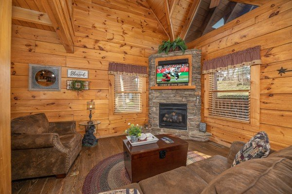 Living room with fireplace & TV at Livin' Simple, a 2 bedroom cabin rental located in Pigeon Forge