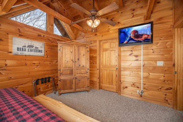 Armoire & TV in a bedroom at Livin' Simple, a 2 bedroom cabin rental located in Pigeon Forge