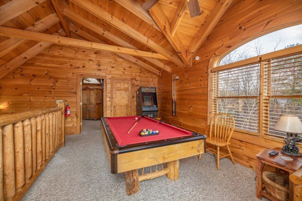 Red felt pool table in the loft at Livin' Simple, a 2 bedroom cabin rental located in Pigeon Forge