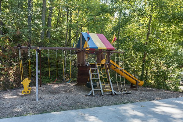 Playground for guests at Top of the Way, a 2 bedroom cabin rental located in Pigeon Forge
