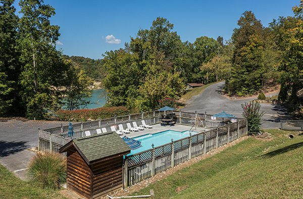 Pool and lake view at Top of the Way, a 2 bedroom cabin rental located in Pigeon Forge