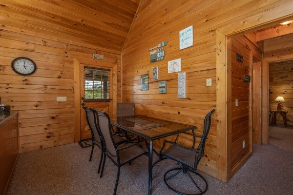 Dining table for four at Top of the Way, a 2 bedroom cabin rental located in Pigeon Forge