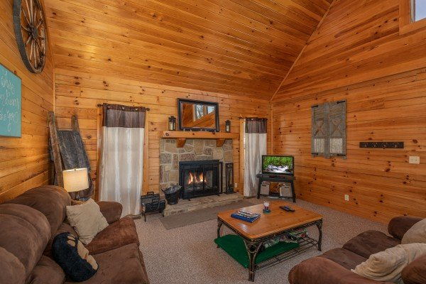 Fireplace and TV at Top of the Way, a 2 bedroom cabin rental located in Pigeon Forge