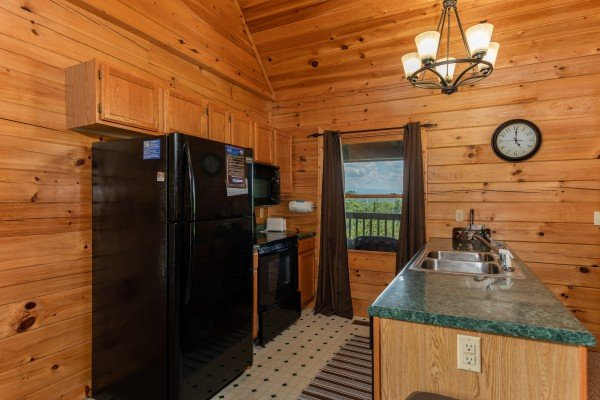 Kitchen with black appliances at Top of the Way, a 2 bedroom cabin rental located in Pigeon Forge