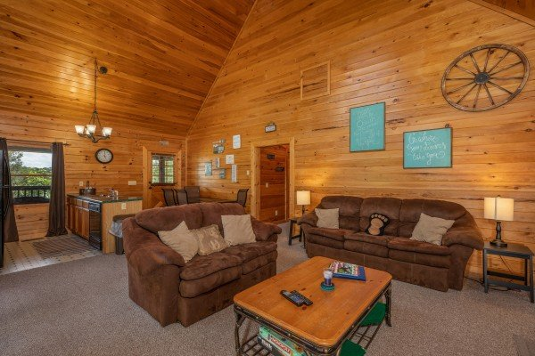 Living room with sofa and love seat at Top of the Way, a 2 bedroom cabin rental located in Pigeon Forge