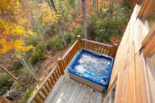 hot tub as seen from the second floor deck at american dream a 2 bedroom cabin rental located in gatlinburg