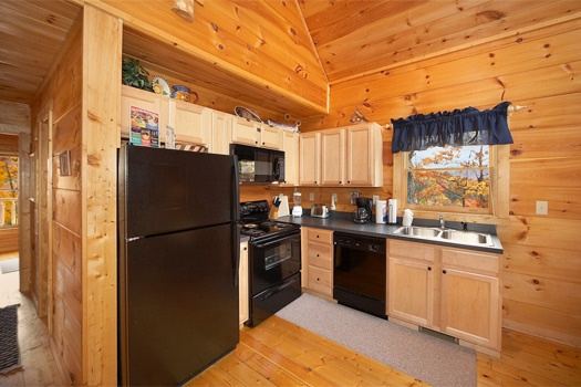 kitchen at american dream a 2 bedroom cabin rental located in gatlinburg