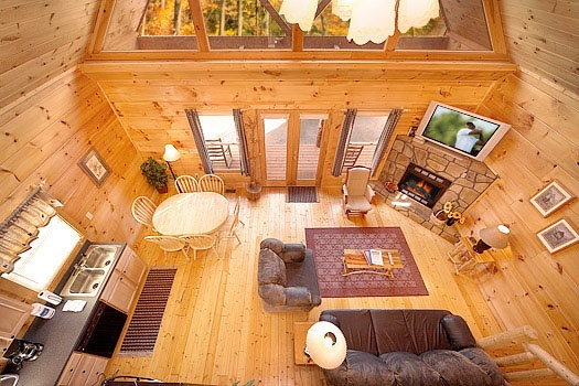 living room view from landing at top of staircase at american dream a 2 bedroom cabin rental located in gatlinburg