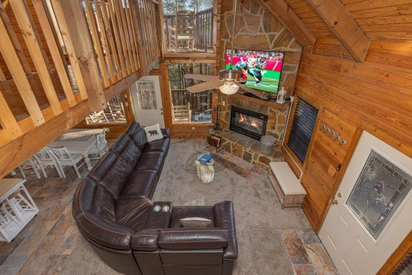 Fireplace and TV in a bedroom at Eagle Watch Den, a 5 bedroom cabin rental located in Pigeon Forge