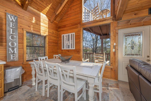 Dining table for 8 at Eagle Watch Den, a 5 bedroom cabin rental located in Pigeon Forge