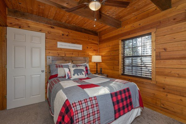 Bedroom with a full size bed at Eagle Watch Den, a 5 bedroom cabin rental located in Pigeon Forge