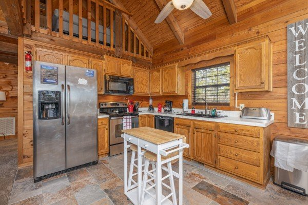 Kitchen with stainless appliances at Eagle Watch Den, a 5 bedroom cabin rental located in Pigeon Forge