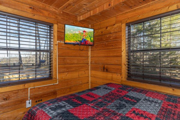TV in a bedroom at Eagle Watch Den, a 5 bedroom cabin rental located in Pigeon Forge