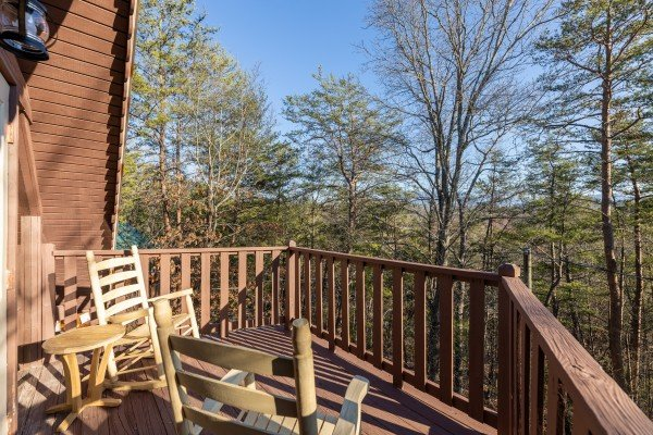 Upper deck at Eagle Watch Den, a 5 bedroom cabin rental located in Pigeon Forge