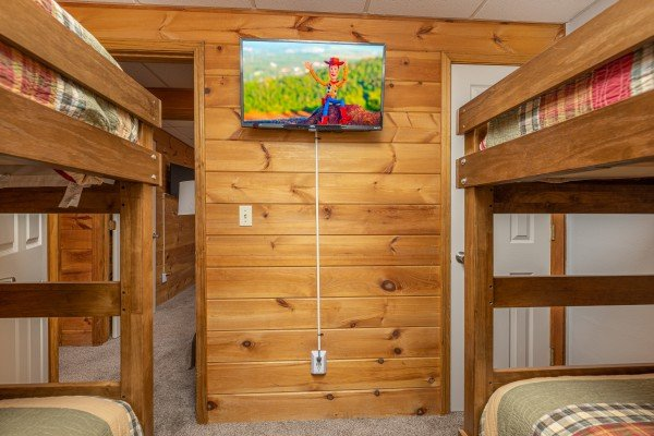 TV in the bunk room at Eagle Watch Den, a 5 bedroom cabin rental located in Pigeon Forge