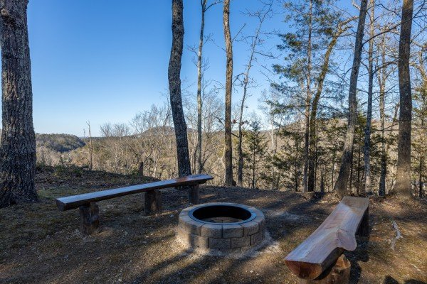 Fire pit and benches at Eagle Watch Den, a 5 bedroom cabin rental located in Pigeon Forge