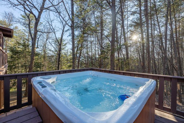 Hot tub and wooded views at Eagle Watch Den, a 5 bedroom cabin rental located in Pigeon Forge