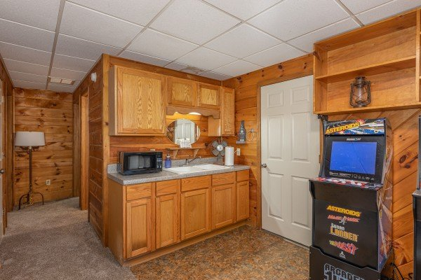 Kitchenette with video game in the game room at Eagle Watch Den, a 5 bedroom cabin rental located in Pigeon Forge