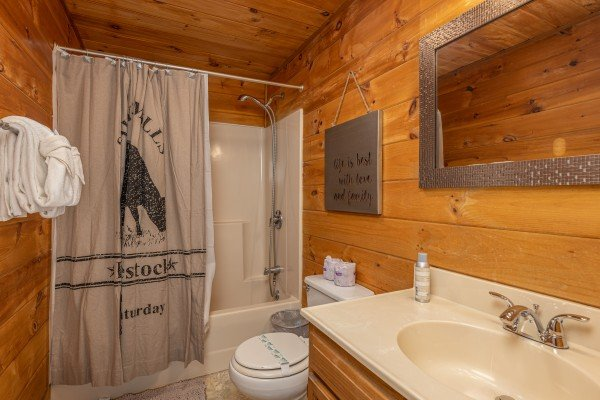 Bathroom with a tub and shower at Eagle Watch Den, a 5 bedroom cabin rental located in Pigeon Forge