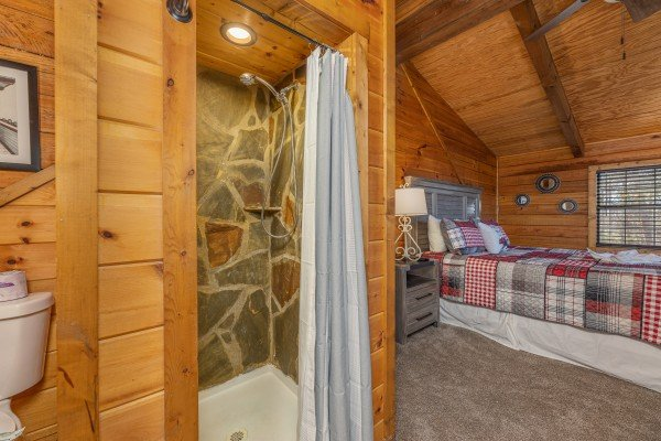 In room bathroom with a stone shower at Eagle Watch Den, a 5 bedroom cabin rental located in Pigeon Forge