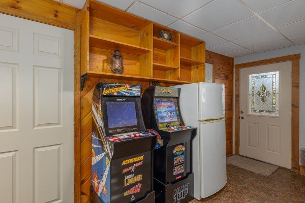 Video games and small fridge in the game room at Eagle Watch Den, a 5 bedroom cabin rental located in Pigeon Forge
