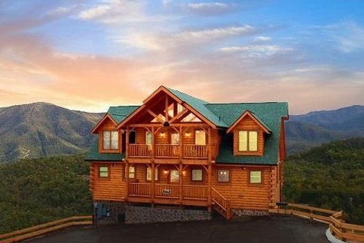 Sunset behind Grand Timber Lodge, a 5-bedroom cabin rental located in Pigeon Forge