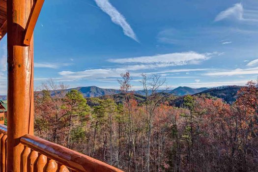 Mountain views with vibrant fall colors at Grand Timber Lodge, a 5-bedroom cabin rental located in Pigeon Forge