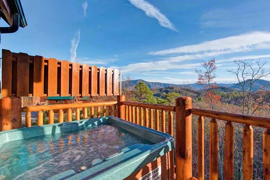 Hot tub views in the fall at Grand Timber Lodge, a 5-bedroom cabin rental located in Pigeon Forge