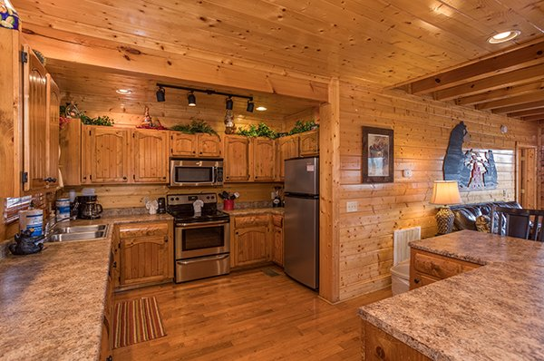 Kitchen with stainless appliances at Grand Timber Lodge, a 5-bedroom cabin rental located in Pigeon Forge