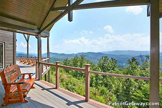 Bench glider on the deck at Grande Mountain Lodge, a 5-bedroom cabin rental located in Pigeon Forge
