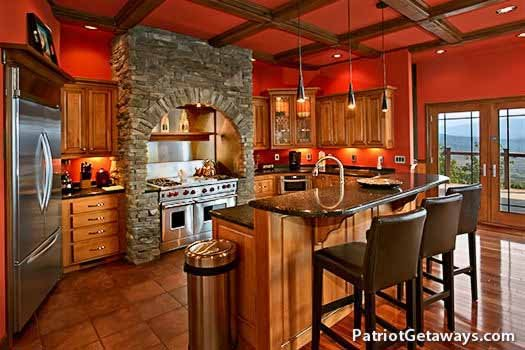 Luxurious kitchen at Grande Mountain Lodge, a 5-bedroom cabin rental located in Pigeon Forge