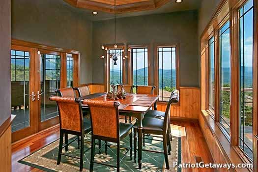 Dining room table with seats for eight at Grande Mountain Lodge, a 5-bedroom cabin rental located in Pigeon Forge