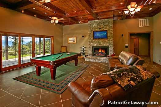 Pool table in the game room at Grande Mountain Lodge, a 5-bedroom cabin rental located in Pigeon Forge