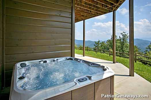 Hot tub on patio at Grande Mountain Lodge, a 5-bedroom cabin rental located in Pigeon Forge