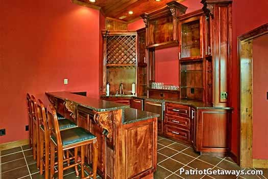 Wet bar kitchenette in game room at Grande Mountain Lodge, a 5-bedroom cabin rental located in Pigeon Forge