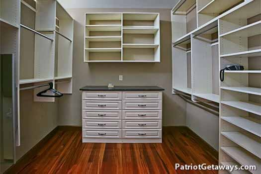 Custom closet organization system in main floor bedroom at Grande Mountain Lodge, a 5-bedroom cabin rental located in Pigeon Forge