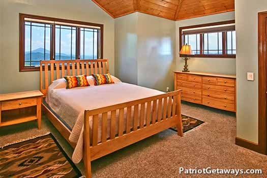 queen sized bedroom on third floor at grande mountain lodge a 5 bedroom cabin rental located in pigeon forge