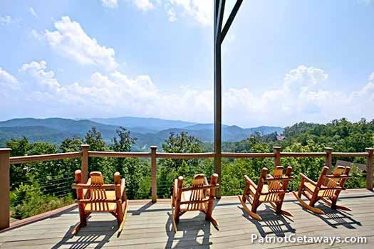 Rockers facing the smoky mountains on the deck at Grande Mountain Lodge, a 5-bedroom cabin rental located in Pigeon Forge