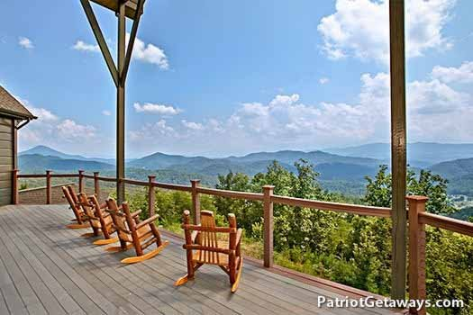 Rockers on the deck facing the Smoky Mountains at Grande Mountain Lodge, a 5-bedroom cabin rental located in Pigeon Forge