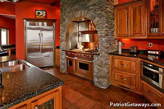 Stone arch over stainless stove at Grande Mountain Lodge, a 5-bedroom cabin rental located in Pigeon Forge