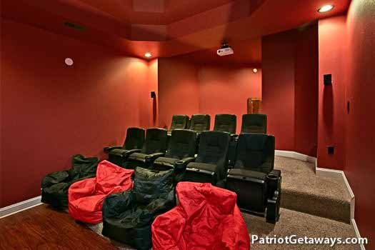 Theater room seating at Grande Mountain Lodge, a 5-bedroom cabin rental located in Pigeon Forge