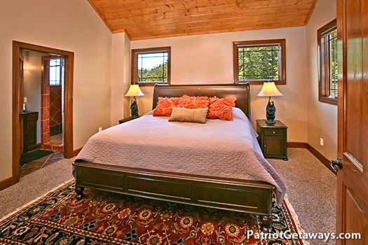 third floor bedroom with king bed and ensuite at grande mountain lodge a 5 bedroom cabin rental located in pigeon forge